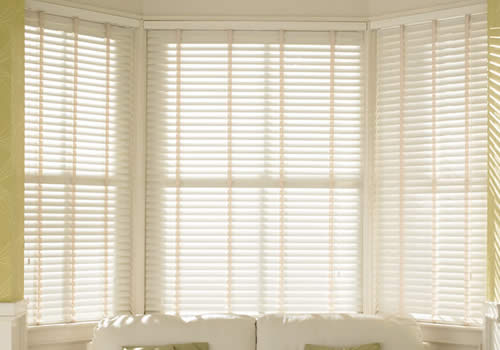 Wood Venetians in bay window - chalk white